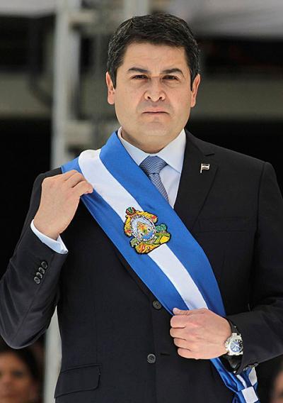Honduran President Juan Orlando Hernandez adjusts the presidential sash during his inauguration ceremony in Tegucigalpa Jan. 27.