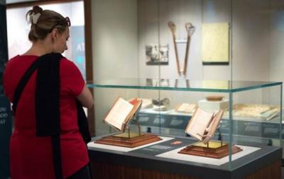 "Visitors at the Smithsonian Institution's National Museum of American History in Washington check out the exhibit ""Religion in Early America"" July 26. The exhibit will be on display until June 3, 2018."