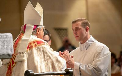<p>Deacon Joseph Martuscello kneels before Bishop Salvatore R. Matano at Rochester's Sacred Heart Cathedral during the deacon ordination May 25, 2019. </p>