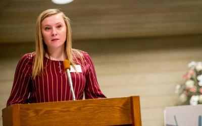 <p>Caelan Murphy of St. Catherine of Siena Church in Ithaca gives her youth witness speech during the Jan. 30 Hands of Christ Recognition Ceremony at St. Mary Our Mother Church in Horseheads..</p>