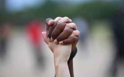 <p>A man and woman hold hands in London&rsquo;s Hyde Park during a &ldquo;Black Lives Matter&rdquo; protest June 3 following the death of George Floyd, an African-American man who died after being taken into custody by Minneapolis police. (CNS photo by Dylan Martinez/Reuters)  </p>