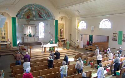 <p>Parishioners attending Mass at Webster&rsquo;s Holy Trinity Church June 15 can be seen maintaining social-distancing practices. (Courier screen capture via livestream)  </p>