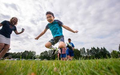 <p>Second-grader Caleb Vanphila sees how far he can jump during a field day activity June 18, 2019, at Irondequoit&rsquo;s St. Kateri School. A photo gallery containing this photo received first-place honors from the Catholic Press Association. (Courier photo by Jeff Witherow)  </p>