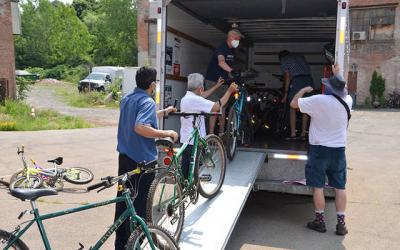 <p>The Diocese of Rochester&rsquo;s migrant ministry team worked with R Community Bikes in Rochester to distribute bikes and helmets to members of the migrant community in Marion in early July. (Photo courtesy of Carmen Rollinson)  </p>