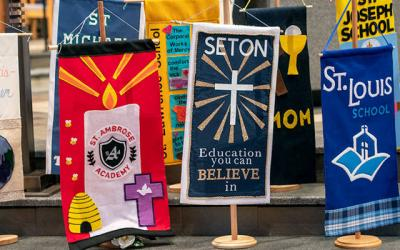 <p>Banners of diocesan schools are displayed during the Catholic Schools Week Mass Jan. 29.