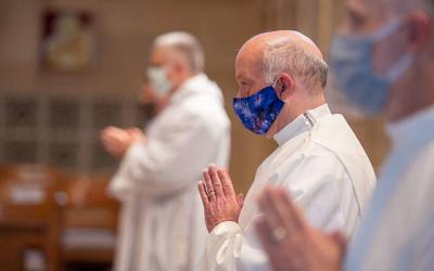 <p>Roger Loucks stands after processing into Sacred Heart Cathedral for the Aug. 15 Mass for the Ordination to the Order of the Deacon.  </p>