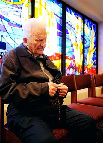 Harold Strassner prays in the adoration chapel at St. Theodore Church in Gates Nov. 17. (Courier photo by Mike Crupi)