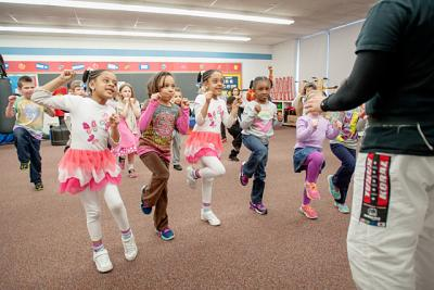 First-graders and kindergartners take part in a March 27 martial arts demonstration at St. John Neumann School in Rochester.