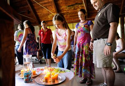Participants in Camp Koinonia's Family Camp pick out friendship bracelets during morning prayer in this July 2011 file photo.
