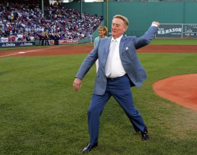 Los Angeles Dodgers Hall of Fame announcer Vin Scully throws out the ceremonial first pitch in early June prior to the first game ever between the Los Angeles Dodgers and the Boston Red Sox at Fenway Park in Boston. Scully will likely retire after the 2016 season, his 67th announcing games for the franchise.