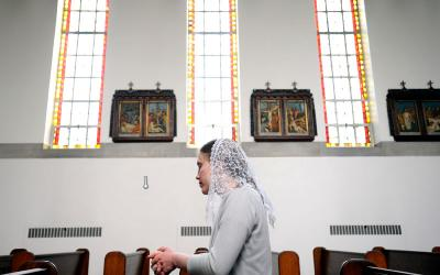 Michelle Raczka prays inside the chapel at the Carmelite Monastery in Pittsford April 26. (Courier photo by Mike Crupi)