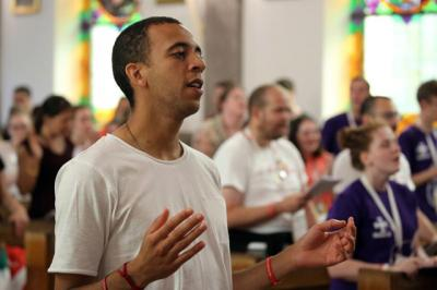Sean Goug, 26, of England, prays at Sacred Heart Church in Krakow, Poland, July 28.
