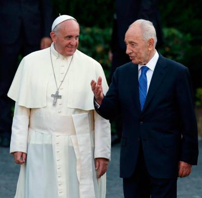 Pope Francis and former Israeli President Shimon Peres arrive for an invocation for peace in 2014 at the Vatican Gardens. Peres, who dedicated himself to the work of achieving peace during the last years of his life, died Sept. 28 at age 93.
