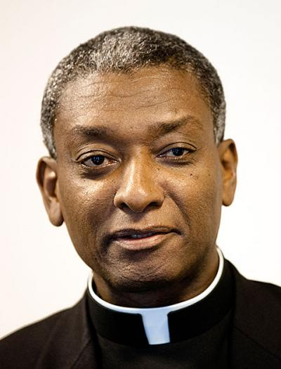Bishop Chibly Langlois of Les Cayes, Haiti, is among 19 new cardinals named by Pope Francis Jan. 12. At age 55 he is the youngest and also the only non-archbishop in the group. Bishop Langlois is pictured during an 2012 interview with Catholic News Service in Washington.