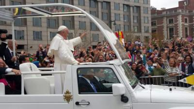 Pope Francis waves to the crowd gathered along the Benjamin Franklin Parkway in Philadelphia Sept. 27.