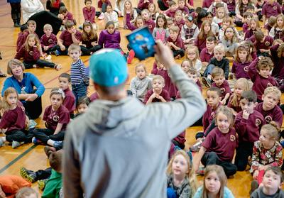 During a Jan. 13 visit to St. Kateri School in Irondequoit, Rochester Knighthawks player Joe Walters talks to students about signing an antibullying pledge.