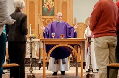 Syracuse Bishop Robert J. Cunningham celebrates Mass at the Pastoral Center chapel Dec. 13. Bishop Cunningham served as apostolic administrator for the Diocese of Rochester for 15 months.