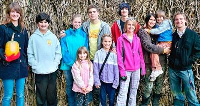 Stephanie and Greg Hubbel's nine children are shown in this 2010 photo. In the front row are Lily (from left), Maria and Sarah. In the back row are Anna, (from left) Noah, friend Jill Ralph, James, Thomas, Rebecca, Grace and friend Andrew Adams.