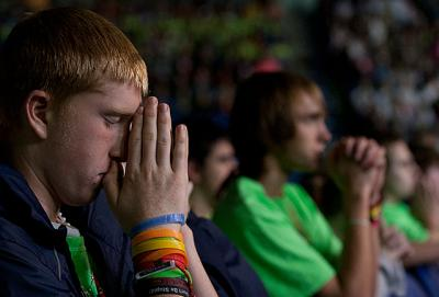 Dan Raftis, 15, from St. Patrick Church in Owego prays after receiving communion during the closing Mass of the National Catholic Youth Conference Saturday, Nov. 23 in Lucas Oil Stadium in Indianapolis.