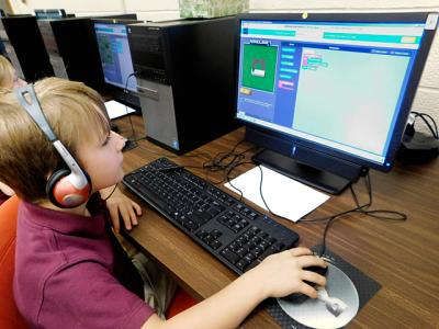 Third-grader Jacek Bartoszewicki works on the code.org website Dec. 17 at St. Kateri School in Irondequoit.