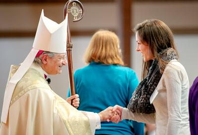 Bishop Matano greets Nicole Northrup, a parishioner of St. Joseph in Penfield who was presented as a catechumen during the 2015 Rite of Election service at Sacred Heart Cathedral.