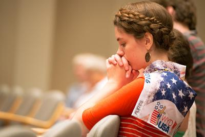 Mary Weeg kneels in prayer during Mass.