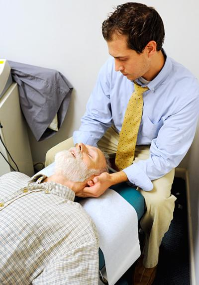 Chiropractic intern Daniel Piccillo treats James Reilly at Rochester's Mercy Outreach Center in 2009.