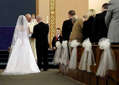 Father Alexander Bradshaw presides at Lisa Coia and Alan Bubel's wedding Mass at Greece's Our Mother of Sorrows Church in December 2008.