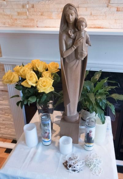 A statue of Mary that was on loan from St. Patrick Parish in Victor was used as part of a family rosary recitation in Farmington April 23.