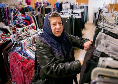 Hildamina Ibrahim looks through clothing at Matthew's Closet in Rochester Nov. 15.