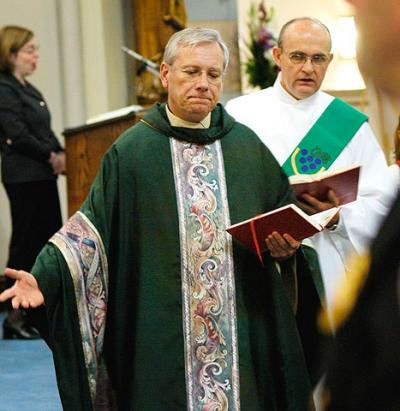 Father Robert Kennedy, chair of the Diocesan Liturgical Commission, celebrates Mass at Rochester's Blessed Sacrament Church. (Courier file photo)