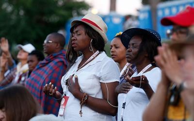 People pray during the worldwide jubilee gathering marking the 50th anniversary of the Catholic charismatic renewal at the Circus Maximus in Rome June 2, 2017.