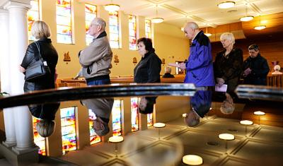 People line up to receive the sacrament of penance at Irondequoit's Christ the King Church during the inaugural Day of Penance in 2013. A diocesanwide Day of Penance will take place again this Lent.