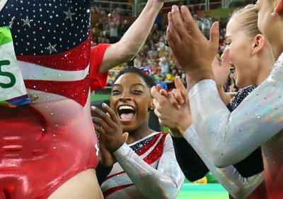 U.S. gymnast Simone Biles, a Catholic, celebrates with her teammates following her floor routine during the Summer Olympics in Rio de Janeiro Aug. 9.