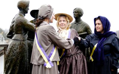 Jennifer Fanning (from left), Kimberly Burke and Michelle Carmen re-enact the first meeting of Susan B. Anthony and Elizabeth Cady Stanton Nov. 8 in Seneca Falls.
