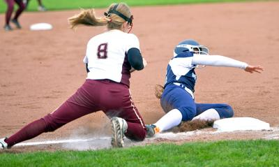 During the May 27 Section 5 Class A1 softball final, Mercy's Olivia Ortega slides safely into third under the tag of Pittsford Mendon's Hannah Trumble.