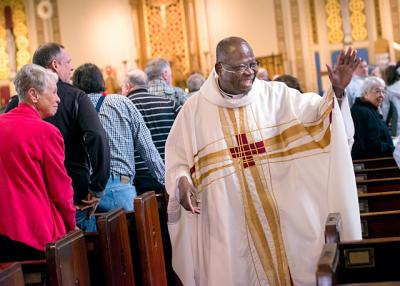 Father Peter Anglaaere greets parishioners before an April 30 Mass at Hornell's St. Ann Church.