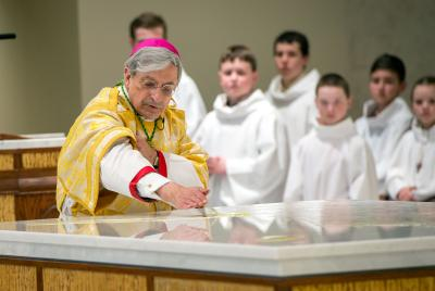 Bishop Salvatore R. Matano anoints the altar with oils during the Solemn Mass of Dedication at the newly built St. Pius Tenth Church in Chili March 19.