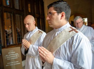 Then-Deacons Matthew J. Walter (left) and Daniel L. White process into Rochester's Sacred Heart Cathedral at the start of the priestly ordination Mass June 1.