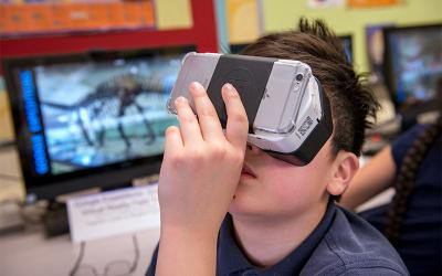 Fifth-grader Aaron Sheu uses virtual reality technology to tour a museum from his classroom at St. Louis School in Pittsford May 1. (Courier photo by Jeff Witherow)