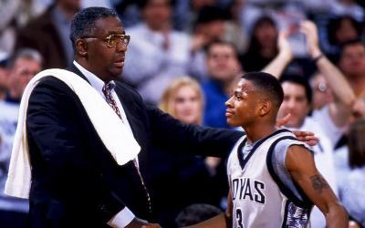 John Thompson Jr. on the basketball court speaking to a player