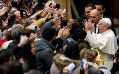 Pope Francis greets people in audience