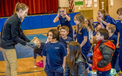 """<p>Educator Bree Riesbeck of the Tanglewood Nature Center in Elmira, NY introduces """"Sir Snuffles"""" a Hedgehog to the amazed students at Elmira's Holy Family Catholic School. (Photo by Rick Bacmanski)  </p>"""