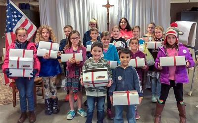 St. James Faith Formation students pose with their Box of Joy projects. (Photo courtesy of Julie Durand)