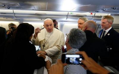 Pope Francis greets journalists on plane