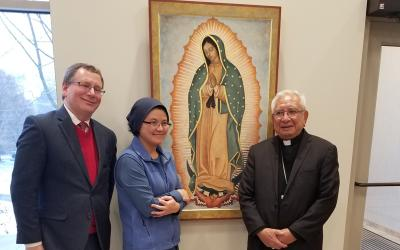 Minhhang K. Huynh (center) posed for pictures Dec. 10 with Bishop Emeritus of Las Cruces Ricardo Ramirez, C.S.B. (right) and Timothy Matovina from the University of Notre Dame near the painting Huynh she created for the Hermance Family Chapel of St. Basil the Great Chapel at St. John Fisher College. The painting was proposed by Fisher's Latino Student Union, and was dedicated in honor of Father Leo Hetzler, C.S.B., who died May 18 at age 91. (Courier Photo by Annette Jiménez)