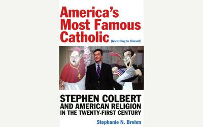 """This is the book cover of """"America's Most Famous Catholic (According to Himself): Stephen Colbert and American Religion in the Twenty-First Century"""" by Stephanie N. Brehm."""