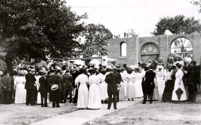 Parishioners attend the cornerstone laying of the original Sacred Heart Church on July 9, 1911.  The church, which stood on the south side of Flower City Park, occupied the first floor of what later became Sacred Heart School.