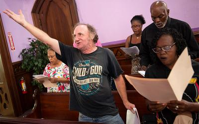 Charlie Lemon and fellow members of the House of Mercy Gospel Choir sing at Central Church of Christ Aug. 22 .