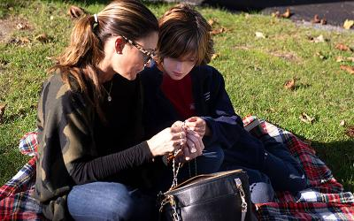 Amanda and Anderson Proia of Spencerport pray the rosary at Holy Cross Church in Rochester Oct. 13 as part of the Rosary Coast to Coast rosary rally.